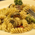 rotini with mushroom and broccoli in a creamy alfredo sauce
