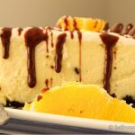 Zesty orange Oreo cheesecake with chocolate drizzle