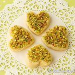 Orange infused mava barfi jewelled with pistachios
