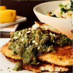 Crispy tilapia in cilantro walnut sauce served with broccoli almond rice